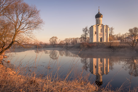 nerl: View to the Church of the Intercession of the Holy Virgin on the Nerl River in the sunlight.