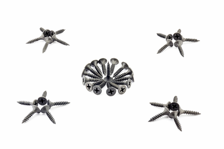 estrellas cinco puntas: Four five-pointed stars and a circular composition are lined with black Oxidized self-tapping screw isolated on white background Foto de archivo