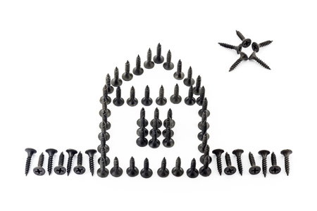 to mend: House with fence and star laid out with Oxidized self-tapping screw isolated on white background