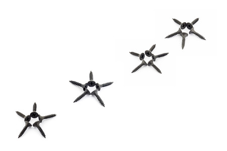 to mend: Five-pointed stars lined diagonally with Oxidized self-tapping screw isolated on white background
