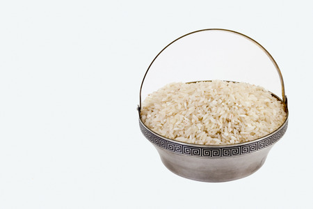 dietary fiber: White rice in rare silver pial isolated on white background