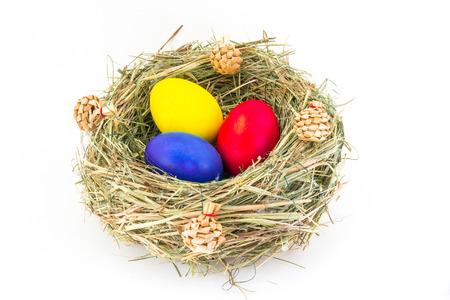 Closeup of easter eggs in handmadde nest