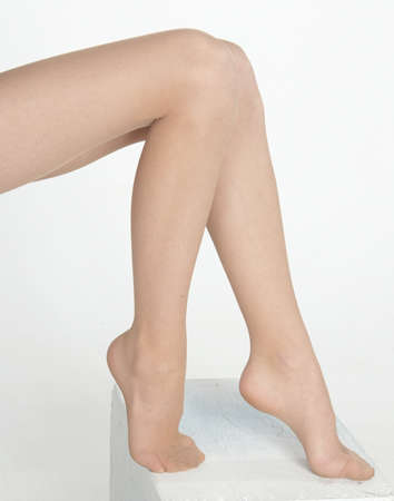 ankles sexy: Womans Legs and Feet in Sheer Pantyhose