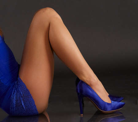 Woman's Legs in Pantyhose and Blue High Heels photo