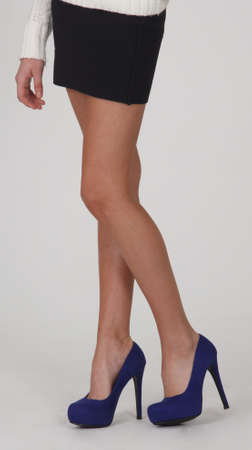 Womans Legs in Blue High Heels and Black Mini Skirt
