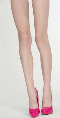 Thin Womans Legs Wearing Pink High Heels photo