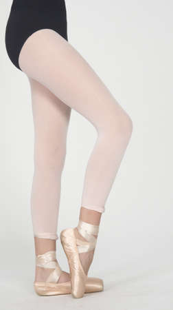 Ballerinas Legs in Tights and Pointe Shoes photo