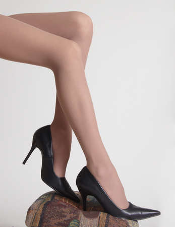 stocking feet: Woman s Legs in Sheer Pantyhose and High Heels Stock Photo