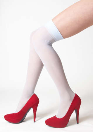 Woman s Legs in Sheer Stockings and High Heels photo