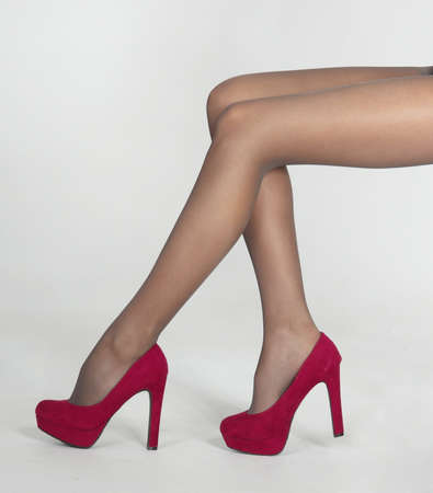 stockings feet: Woman s Legs in Sheer Pantyhose and High Heels Stock Photo