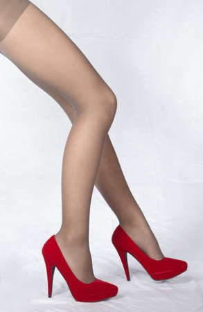 stockings feet: Woman s Legs Wearing Sheer Pantyhose and Red High Heels