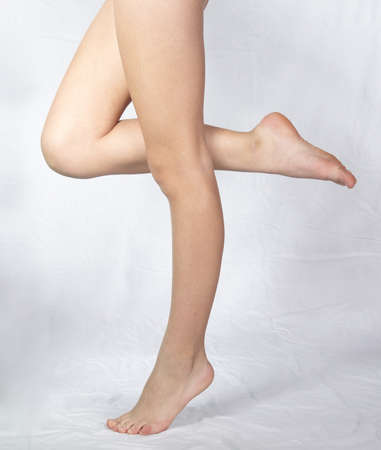 ankles sexy: Woman s Legs Standing Against a White Studio Background