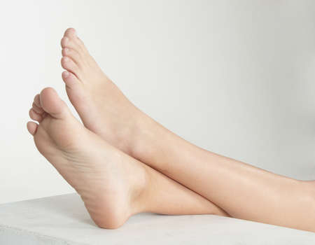 Woman s Bare Feet with her Ankles Crossed and Elevated photo