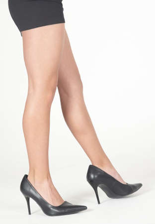 black heels: Woman s Legs Wearing Black Heels and Skirt Stock Photo