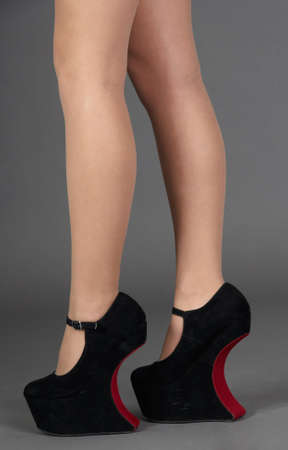 Woman s Legs Wearing No Heel High Platform Shoes photo