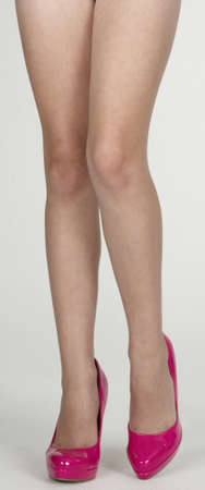 stilettos: Woman s Legs in Pink High Heels