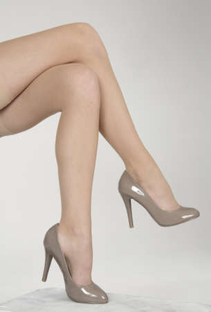 stepping: Close up of woman s legs crossed wearing high heels Stock Photo