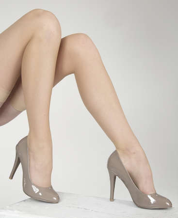 dominance: Close up of woman s legs crossed wearing high heels Stock Photo