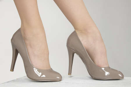 Close up of woman s high heel shoes against a white studio background photo
