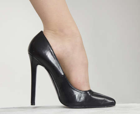 heeled: Close up of woman s high heel shoes against a white studio background