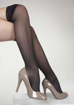leggy girl: Close up of woman s legs crossed wearing high heels Stock Photo