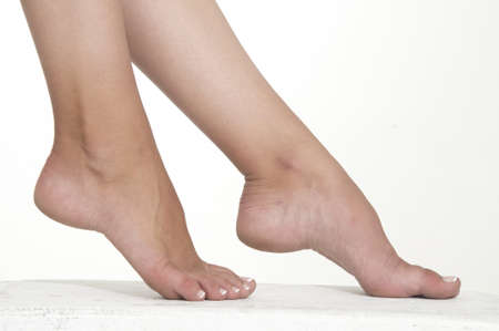 foot fetish: Woman s Bare Foot Against a White Studio Background