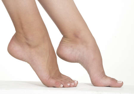 ankles sexy: Woman s Bare Foot Against a White Studio Background
