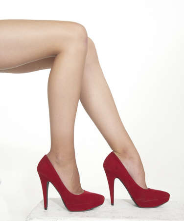 red shoes: Woman s Legs in Red High Heels