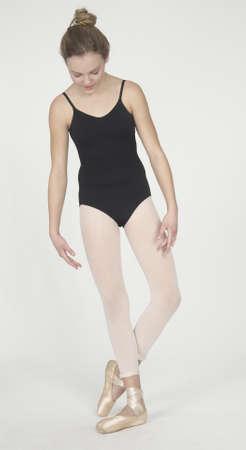 Teen Ballerina in leotard and tights photo