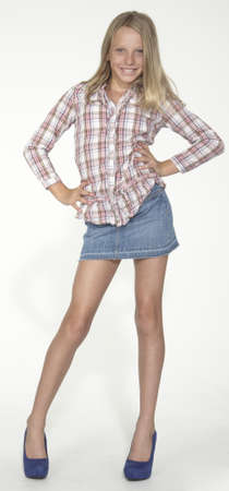 Country Blonde Teen Girl in a Jean Skirt and Heels photo