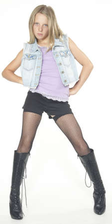 pre teen: Blonde Teen Girl in Leather Boots Stock Photo
