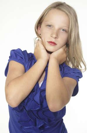 pre teen girl: Head shot portrait of a blond teen girl