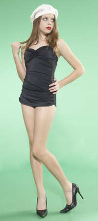 Teen Girl in Vintage One Piece Swim Suit and Cap against a Green Screen Background