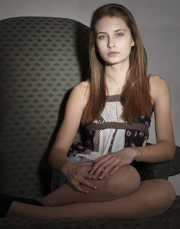 Teen Girl Posing in Dark Portrait Фото со стока