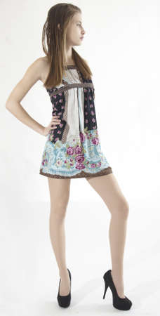 pantimedias: Teen Girl Modelo en Tacones altos Vestido corto y Foto de archivo