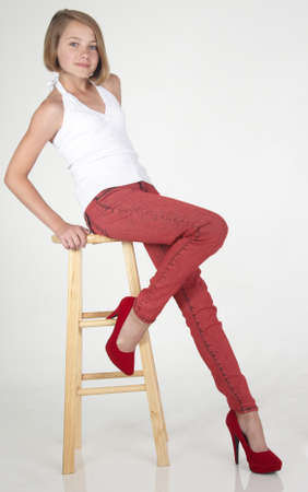 preteens: Pretty Teen Girl in Red Jeans and High Heels Stock Photo