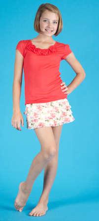 Cute Teen Girl Posing Against a Blue Studio Background photo