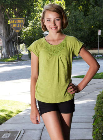 Teen Blond Gril Walking on a Sidewalk in Beverly Hills photo