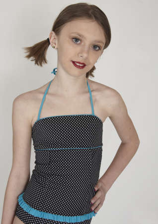 Cute Teen in a Swimsuit and Ponytails photo