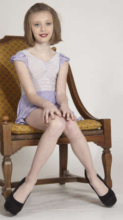 pre teens: Elegant Young Blond Girl Posing in a Dress and High Heels Stock Photo