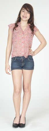 high heeled: Hispanic Teen Girl Posing in Jean Shorts and Heels