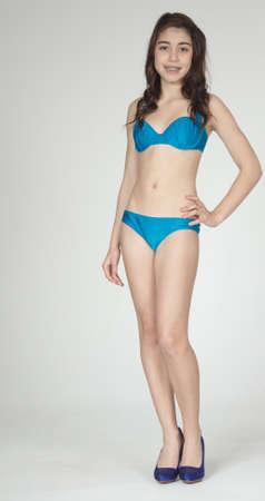 swimming shoes: Hispanic Teen Girl Posing in a Bikini Stock Photo