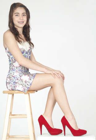 high heeled: Hispanic Teen Girl in a Skirt and Heels