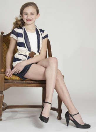 Young Teen Girl Modeling Fashion Clothing in Studio photo