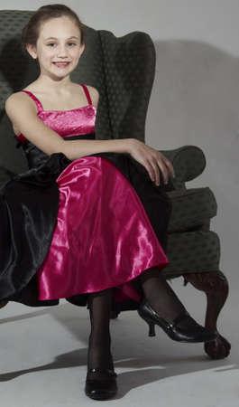 Elegant Young Teen Girl Modeling Fashion Clothing in Studio 스톡 콘텐츠
