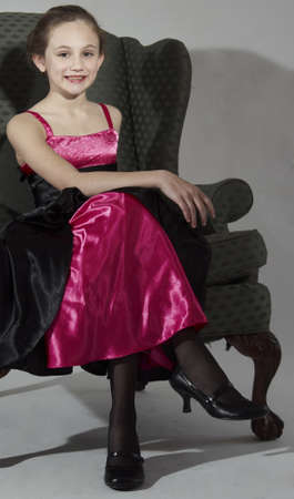 Elegant Young Teen Girl Modeling Fashion Clothing in Studio Фото со стока