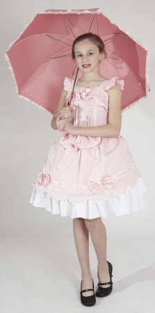 ピンクのイースターのドレスの女の子 写真素材