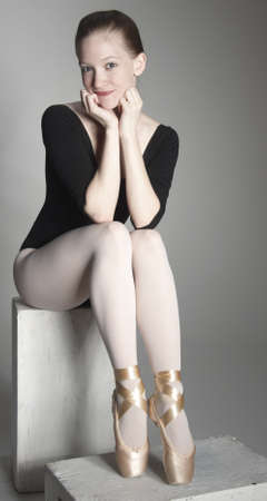 pointe shoe: Ballerina Posing in a Studio Setting Stock Photo