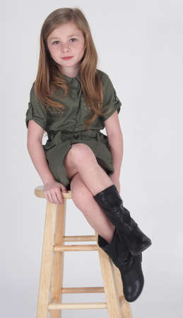 stool:  Preteen Blonde Girl in Shorts and Boots