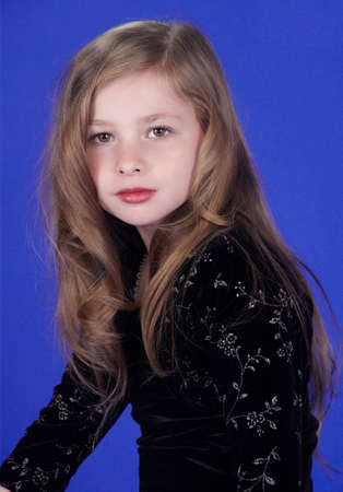 preteen: Blond Teen Girl Portrait Against a Blue Studio Background